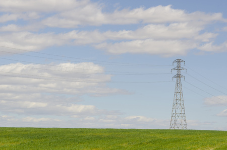 high voltage: High voltage electrical tower in a cloudy day. Concept of energy and environment