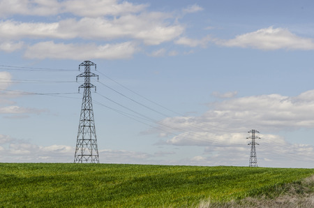 Two High voltage electrical towers in a cloudy day. Concept of energy and environment  photo