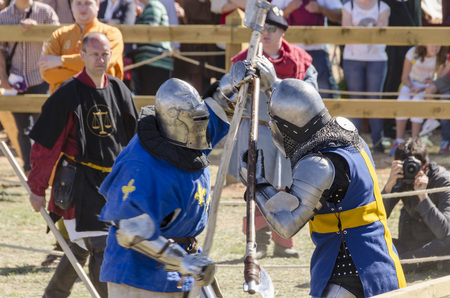 BELMONTE, CUENCA, SPAIN - MAY 1: Two knights fighting in the World championship of Medieval combat on May 1, 2014 in Belmonte, Cuenca, Spain. From May 1 to May 4 Belmonte is celebrating the world Championship of Medieval Combat