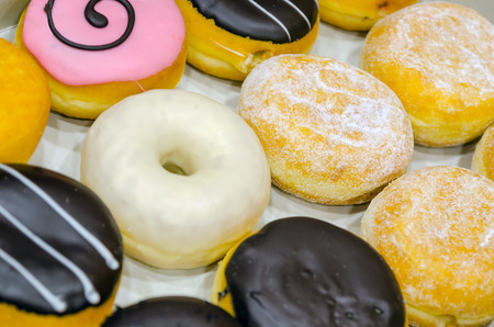 donut shape: Assorted sweet doughnuts ready to be eaten