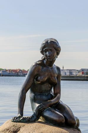 Little mermaid bronze statue in Copenhagen, Denmark