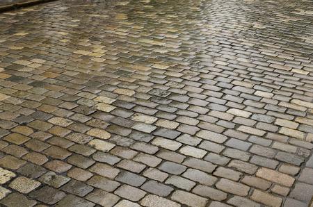 cobblestone street: wet cobblestone street after the rain Stock Photo