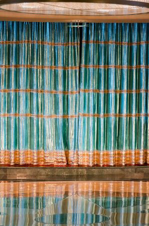 drape: Shining theater curtain in green and gold