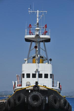 tug boat: Black tugboat moored in the harbor