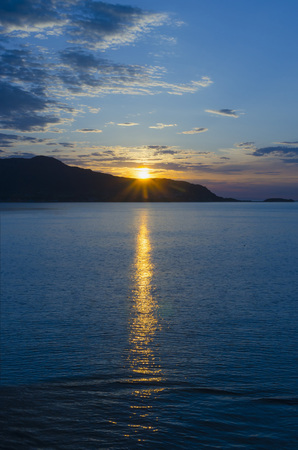 crepuscular: Sunset in the coast with crepuscular rays. God fingers. Good file for backgrounds and wallpaper Stock Photo