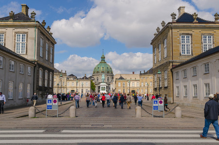 frederik: DENMARK, COPENHAGEN - JUNE 6: Tourist visiting Amalienborg Palace at June 6, 2014. Amalienborg palace is the Danish Royal residence and attracts lots of tourist.