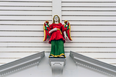 angel figurine: Wooden guardian angel painted in red, gold and green