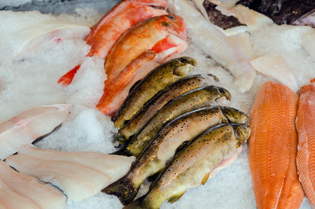 fish market: Fresh fish. Trout, slamon, and snappers in the fish market Stock Photo