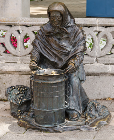 tribute: Bronze statue of a woman selling chestnuts in Burgos, Castile and Leon, Spain