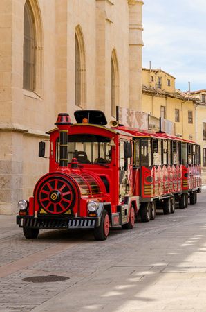 station wagon: A red tourist train in the streets of an spanish city