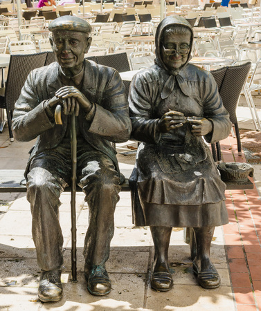 healthy aging: Statue of two elders sitting on a bench. Burgos, Castile and Leon, Spain Editorial