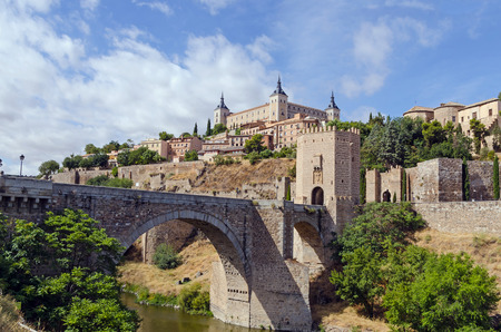Detailed view of Alcantara bridge over river Tajo in Toledo.  photo