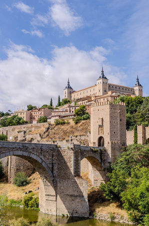 View of the Alcazar as seen near the Alcantara bridge in Toledo. Spain