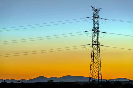 cabling: High voltage tower at late evening. Electrical supply for towns and cities.