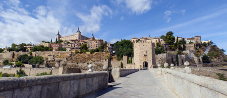 View of the imperial city of Toledo as seen from Alcantara bridge. Spain