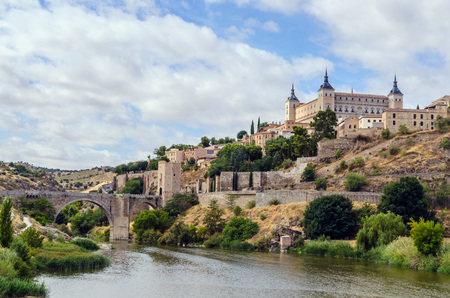 View of the Alcazar as seen near the Alcantara bridge. Toledo. Spain photo