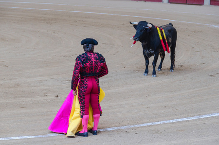 capote: A bullfighter and a bull in the bullring