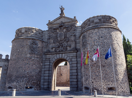 city coat of arms: Bisagra gate facade with coat of arms in the imperial city of Toledo.