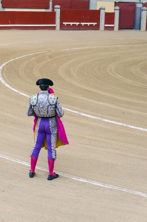 torero: Torero holding his cape is waiting for the bull