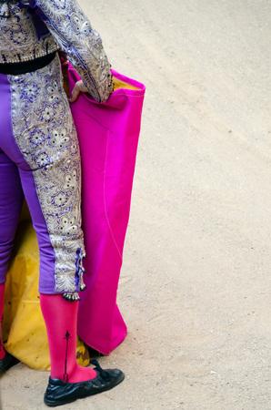 torero: Torero standing with his traditional costume and cape. Bullfighting concept Stock Photo