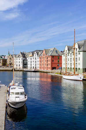 alesund: View of Brosundet canal with yatchs and art nouveau styled houses in Alesund. Norway