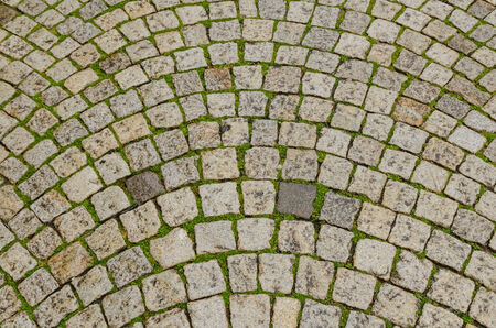 cobblestone street: Ground made with tiled cobblestone in an european street