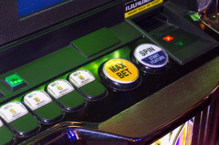 Max bet button in an slots machine. Gaming and luck concept photo