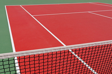 Detail of a tennis playground with a tennis net. Tennis court photo