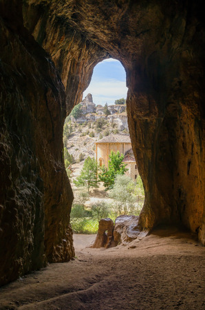 Templar hermitage of Saint Bartholomew of Ucero, as seen from a cave. Rio Lobos Canyon, Soria, Spain photo