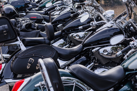 parked: Several motorcycles in black parked in a row Stock Photo