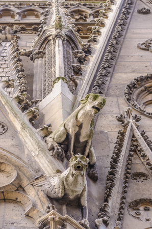 gargoyles: Two gargoyles in the facade of Notre Dame Cathedral, Paris, France Stock Photo