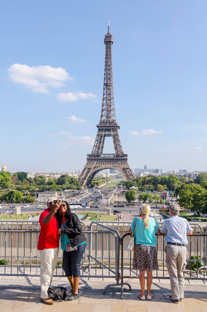 PARIS, FRANCE - SEPT 16: People is taking selfies with eiffel Tower as background on Paris, August, 13, 2014. Paris is one of the most touristic cities in the world