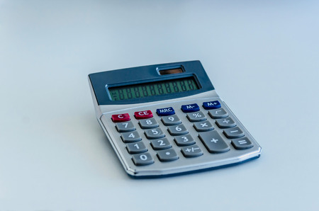 numers: An electronic calculator on the desk. Mathematics and economy concept Stock Photo