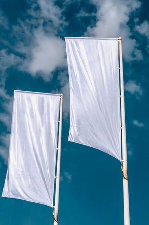 blank banner: Two cleared advertisement flags waving on the sky