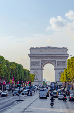gaulle: PARIS, FRANCE - SEPTEMBER, 15: Traffic and tourist  in Champs Elysees Avenue on September,15 2014. Arc de Triomphe stands in the center of the Place Charles de Gaulle at the end of Champs Elysees boulevard