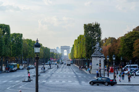 champs elysees quarter: PARIS, FRANCE - SEPTEMBER, 15: Traffic and tourist  in Champs Elysees Boulevard on September,15 2014. Arc de Triomphe stands in the center of the Place Charles de Gaulle. Editorial