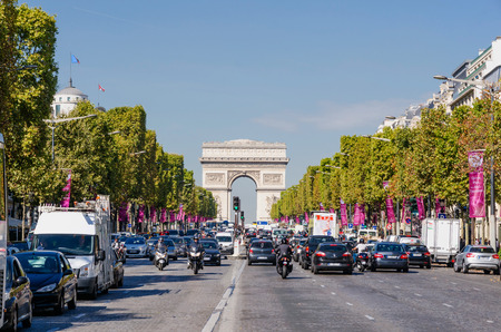 champs elysees quarter: PARIS, FRANCE - SEPTEMBER, 20: Traffic in Champs Elysees Avenue on September,20 2014. Arc de Triomphe stands in the center of the Place Charles de Gaulle.