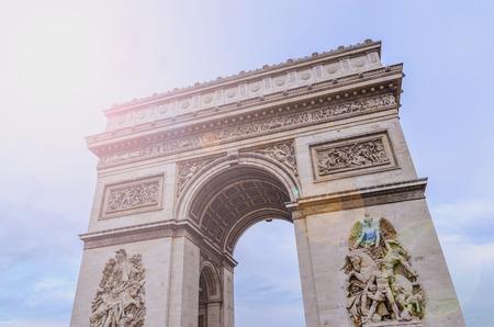 triumphal: Triumphal arch in the city of Paris. Arc de Triomphe. Lens flares effect Stock Photo