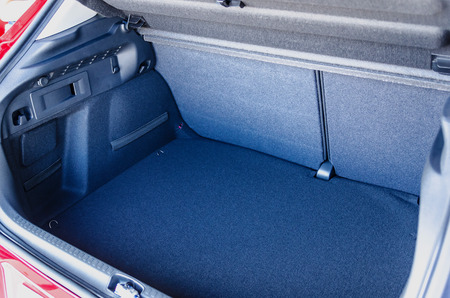 compartments: Empty car trunk with a lot of space for luggage and goods