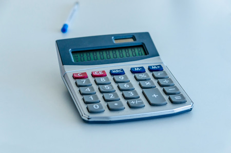 numers: An used calculator on the table