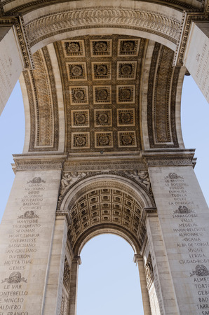 seem: Triumphal arch seem from below. Arc de Triomphe. Paris
