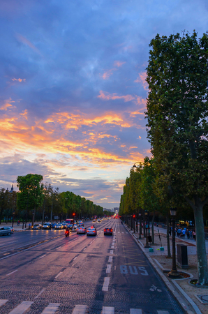 champs elysees quarter: Traffic and tourists  in Champs Elysees Boulevard at sunset Stock Photo