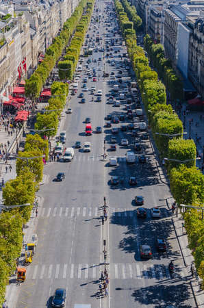 elysees: View of champs elysees boulevard with a lot of traffic.