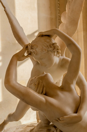 Cupid an Psyche. Two lovers about to give a kiss. Erotic and love concept photo