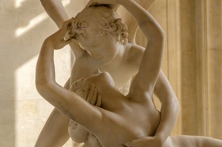 Cupid and Psyche. Two lovers about to give a kiss. Erotic and love concept photo