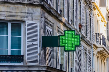 cross street with care: Pharmacy sign in an street of europe. Drugstore.