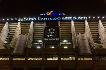 castellana: MADRID, SPAIN - FEBRUARY 4: Facade of the Santiago Bernabeu Stadium on February 4, 2015 in Madrid, Spain. Real Madrid C.F. was born in the year 1902 and Santiago Bernabeu Stadium is its headquarters