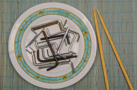 Allen keys in a plate. Eat time. Disgusting food. Impossible food