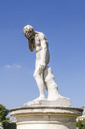 statuary garden: Cain statue in Tuileries garden. Paris, France.