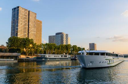 touristic: Touristic boat sailing in the river Seine, Paris, France Editorial
